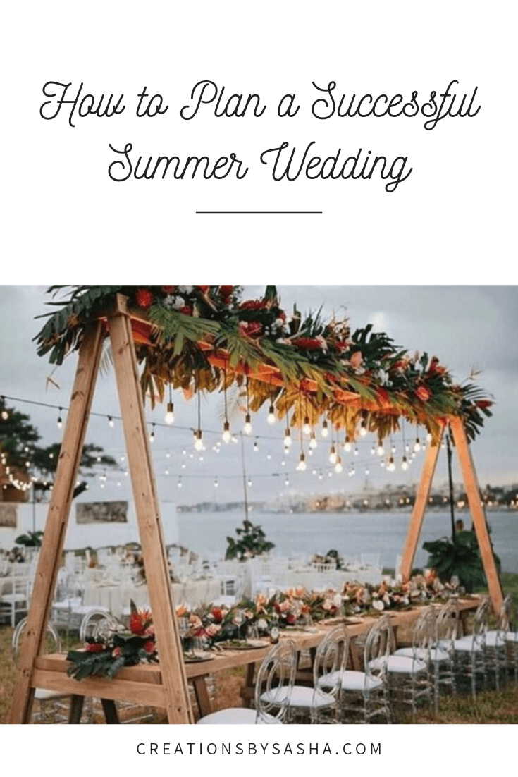 Wedding By the Beach, Guest table with Arch Floral Arrangement - www.by-sasha.com