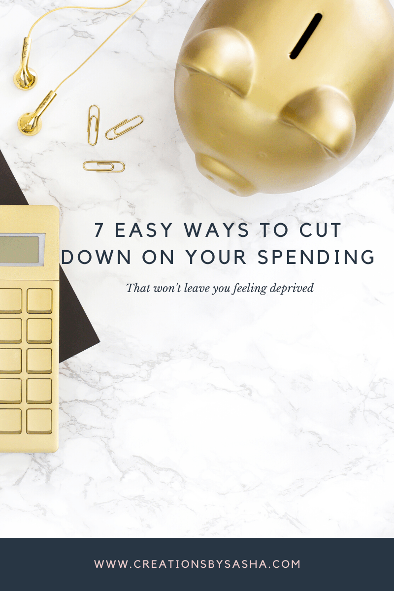 calculator and piggy bank on marble table - 7 Easy Ways to Cut Down on Your Spending - www.by-sasha.com