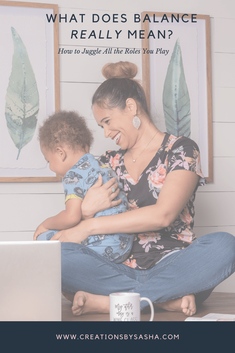 mom with baby and computer - What Does Balance Really Mean? How to Juggle All the Roles You Play - www.by-sasha.com