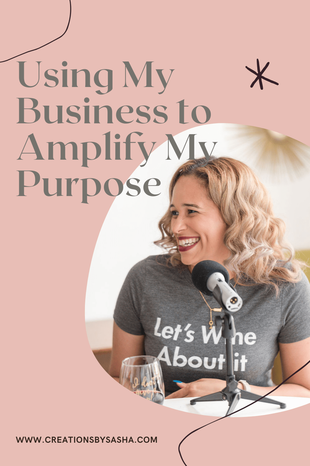 Using My Business to Amplify My Purpose - Sasha sitting in front of a microphone smiling